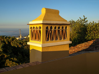 Yellow chimney on a house in the Algarve in southern Portugal.