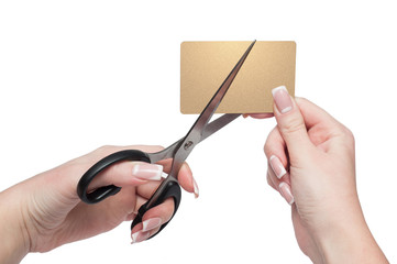 Close-up Of woman Hands Cutting gold Credit Card with scissors