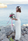 bride near the water, boho style poster