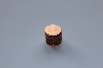Piled up one cents on a white background