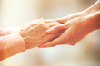 Leinwanddruck Bild - Helping hands, care for the elderly concept