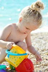 toddler girl   on beach