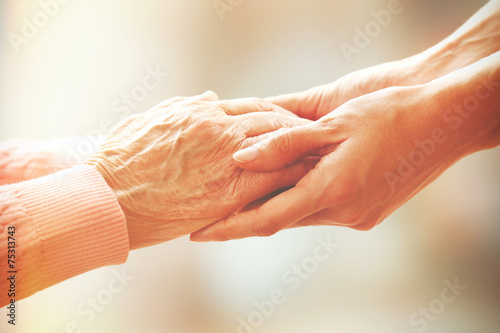 Leinwanddruck Bild Helping hands, care for the elderly concept