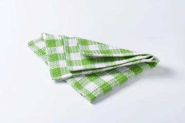 Green and white tea towel