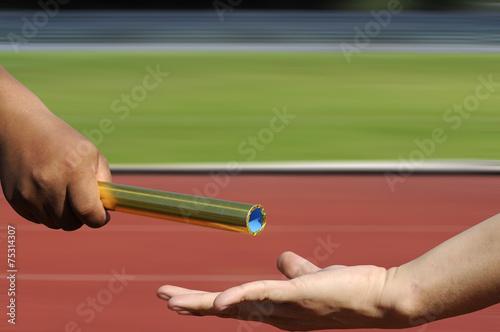 Papiers peints Jogging Relay-athletes hands sending action on blur race track, sport a