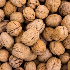 Walnut background.  lot of walnuts in the peel