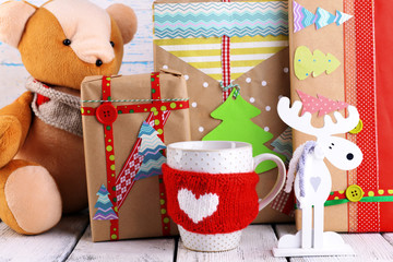 Hand-made Christmas gifts with decorations on wooden background