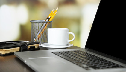 Modern laptop on table, on light background