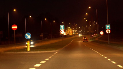 Cars riding on highway at night