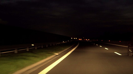Vehicles riding on the road at night