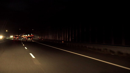 View of cars riding on highway at night