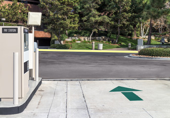 Suburban parking lot exit blocked by pay station gate arm