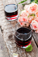 Still Life with Red Wine and Bouquet of Roses