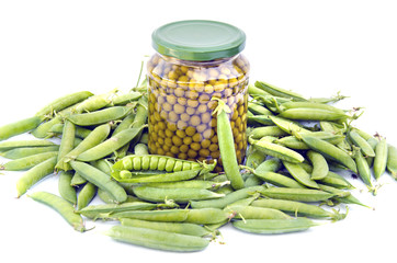 canned green pea in glass jar and fresh pods isolated on white