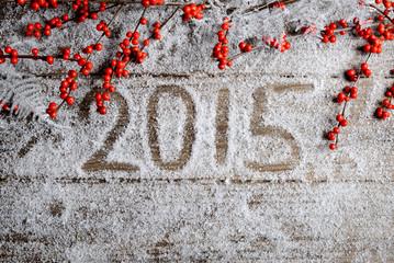 2015. snowy wooden background