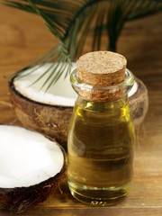 coconut oil in a glass bottle and fresh nuts