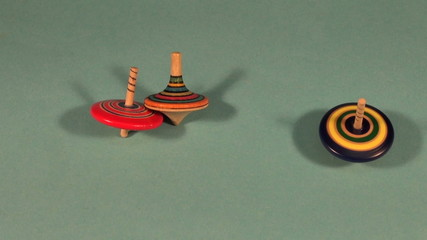 three beautiful happy wooden whirligig toy