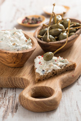 toast with cheese pate and capers
