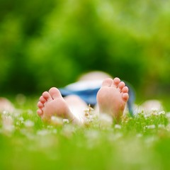 Childrens feet on grass outdoors