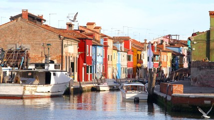 houses of the island of Burano with waterway near Venice