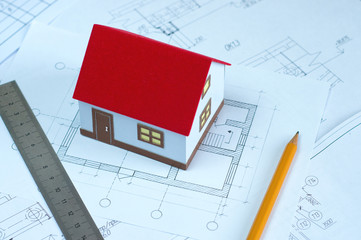 the layout of the house, design and ruler with pencil