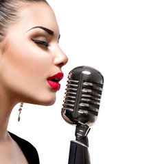 Singing woman with retro microphone. Beauty singer girl © Subbotina Anna