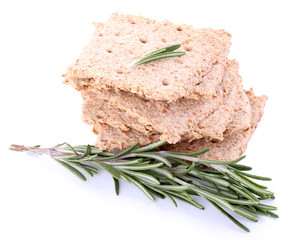 Crispbread with sprigs of rosemary isolated on white background