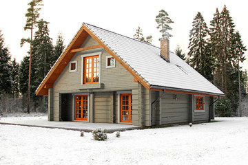 wooden snowy lodge in forest
