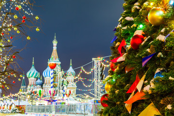 Christmas balls on tree branches in Red square