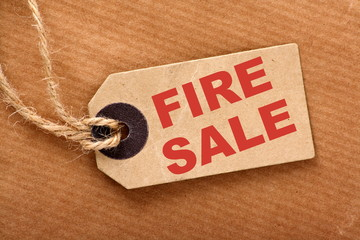 The phrase Fire Sale on a luggage or price tag