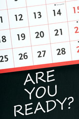 The phrase Are You Ready on a blackboard with a calendar