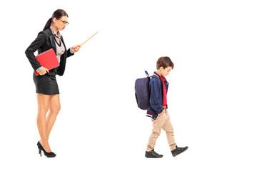 Female teacher disciplining a schoolboy