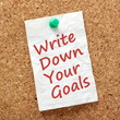 The phrase Write Down Your Goals on a notice board