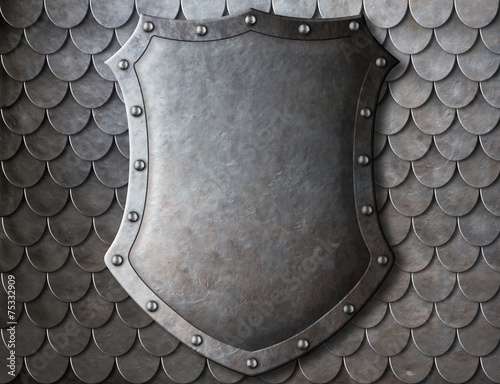 Leinwandbild Motiv old medieval coat of arms shield over scales armour background