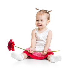 Adorable baby girl sitting with flower isolated