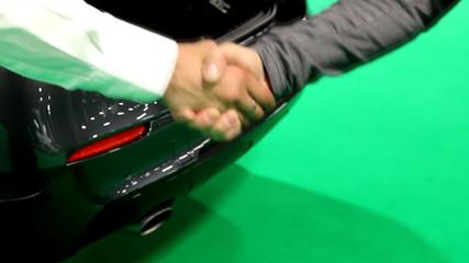Handshake, car sale deal at the car dealer