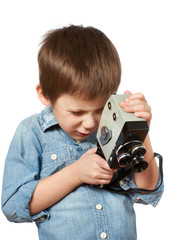 Little boy cameraman filming with retro camera