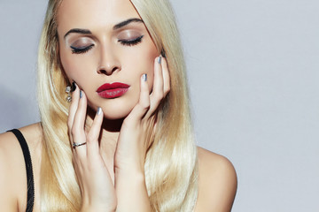 Beautiful blond Woman.make-up.Sexy Beauty Girl.Shellac manicure