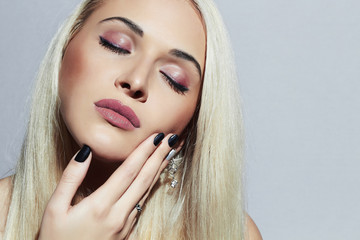 Beautiful blond Woman with Manicure. Sexy Beauty Girl.Make-up