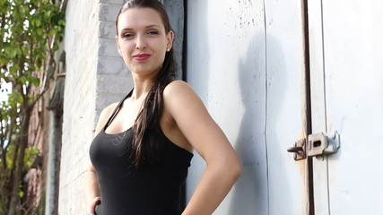 Sexy fashion female outdoors in black dress