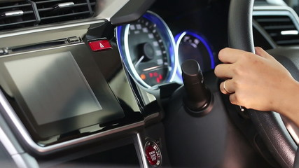 Business woman push start button for starting the engine.