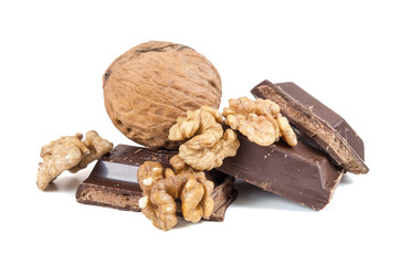 Chocolate pieces and walnuts on white background