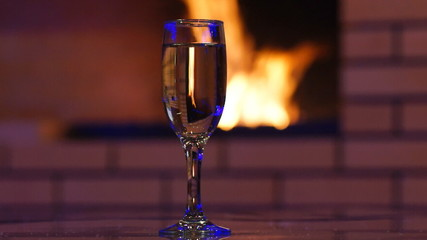 Sparkling wine and fireplace
