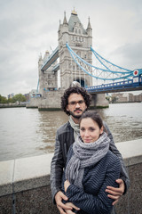 Loving couple in front of Tower Bridge - London