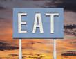 Vintage Blue Eat Sign with Sunset