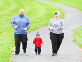 Overweight parents with her son running together.
