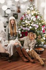 Girls near christmas tree
