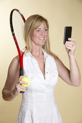 Female tennis player taking a selfie