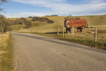 Rural roads and pastures in the Czech Republic, rusty water tank