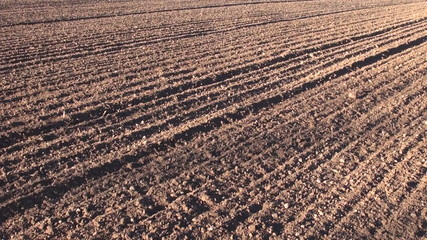 plowed cultivated agriculture farmland field soil